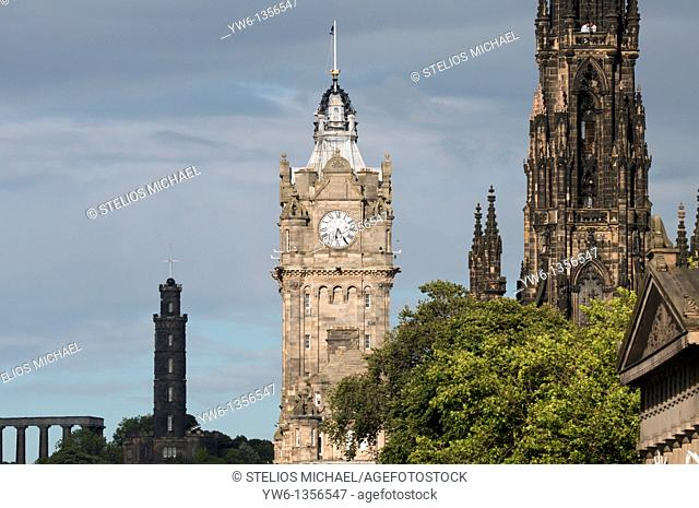 Balmoral Hotel Clock Tower in Edinburgh, with Nelson Monument in the background Taken from Princes street