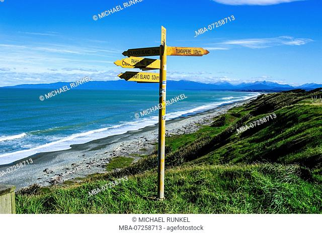 Signpost on Te waewae bay, along the Road from Invergargill to Te Anau, South Island, New Zealand