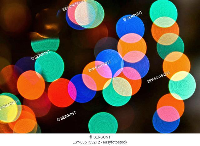 Abstract background bokeh. View Christmas tree lights photographed defocused lens, colorful bokeh