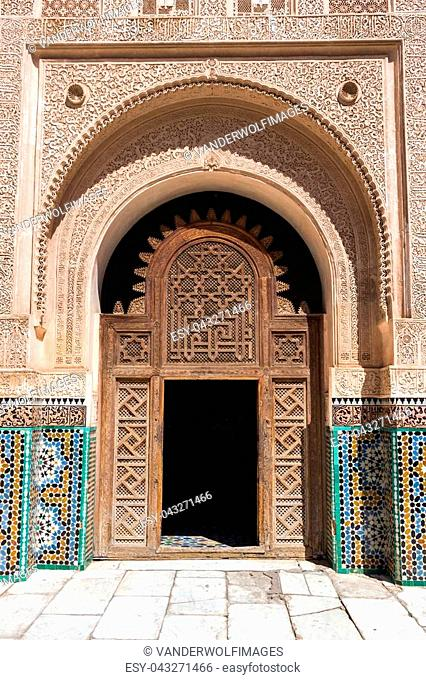 MARRAKESH, MOROCCO - APR 29, 2016: Entrance door in the inner court of the Ben Youssef Madrassa. A former Islamic college in Marrakech, Morocco