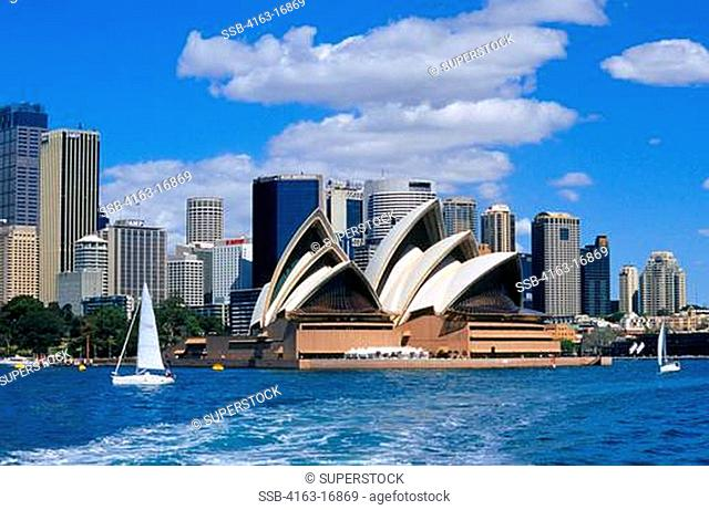 AUSTRALIA, SYDNEY, VIEW OF OPERA HOUSE AND CITY SKYLINE, SAILBOAT