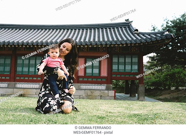 South Korea, Seoul, Mother and baby girl visiting Gyeongbokgung Palace