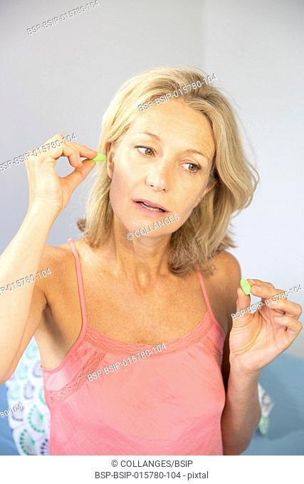 Woman using earplugs