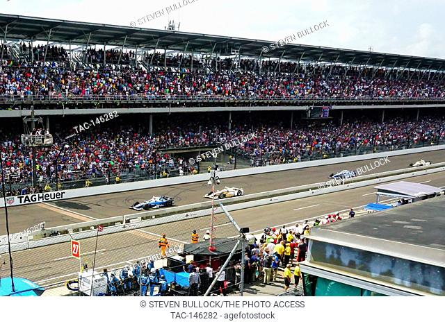 Takuma Sato leads at the last restart of the day at the Indy 500 follwoed by Elio Castroneves