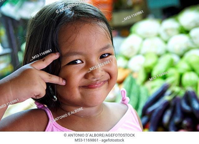 A filipino girl smile and look at camera  Fruits & Vegetable market  Mandaluyong city  Metro Manila  Philippines