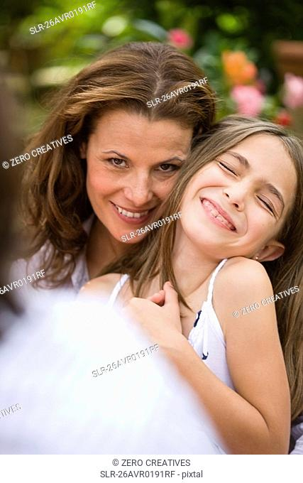 Woman holding a laughing girl