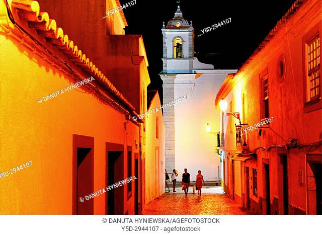 Rua Henrique Correia da Silva at night, belltower of Santa Maria church in background, historic old town of Lagos, Algarve, Portugal, Europe
