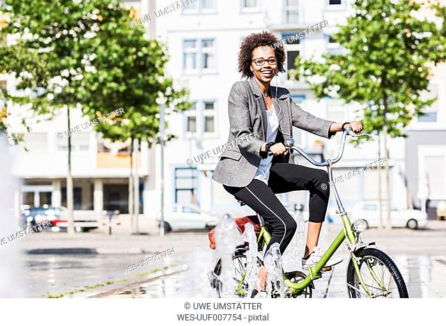 Portrait of smiling woman on bicycle