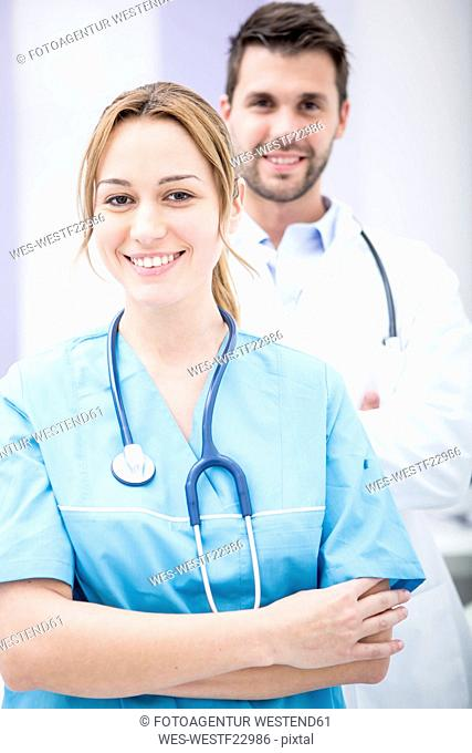 Portrait of two smiling doctors