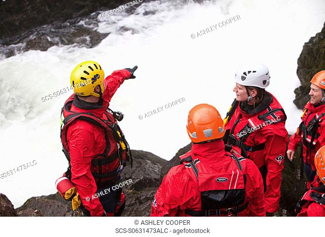 Members of the Langdale/Ambleside Mountain Rescue Team train in Swift water rescue techniques on the River Brathay at Skelwyth, Lake District, UK