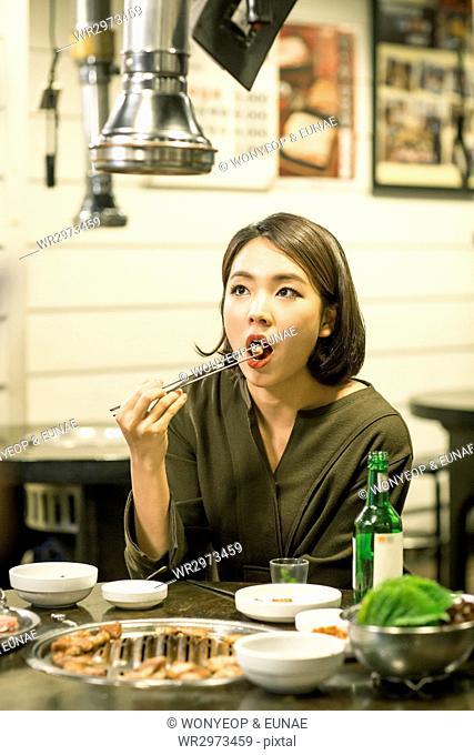 Portrait of single woman at restaurant