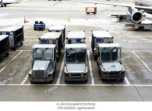 united airlines luggage cars carts parked on a cold wintry day at o'hare international airport chicago usa