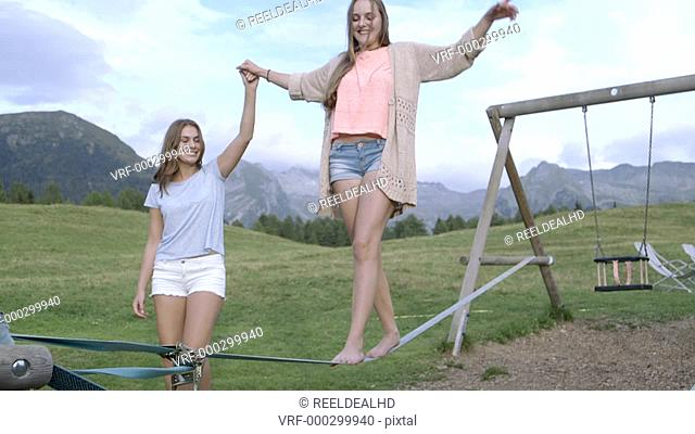 Woman walking on tight rope