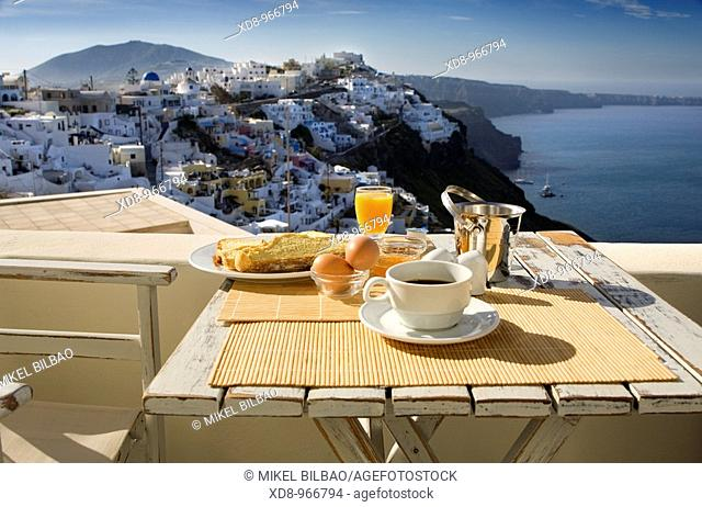 Breakfast and view.Firostefani village. Santorini island, Cyclades islands, Aegean Sea, Greece, Europe