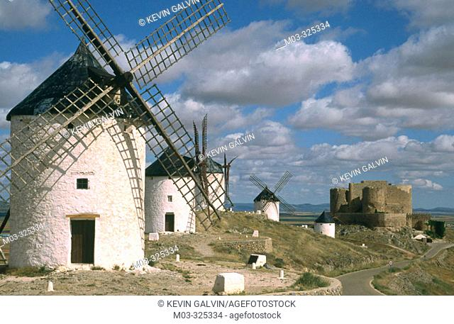 Windmills with castle at backgroung in Consuegra. Toledo province. Castilla-La Mancha. Spain
