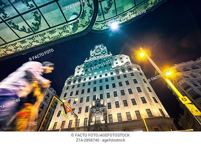 Telefonica building and Gran Via street at night. Madrid, Spain