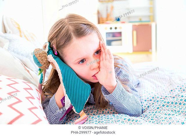 5 year-old girl sucking her thumb