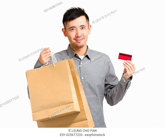 Man hold with shopping bag and credit card