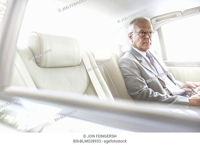 Caucasian businessman sitting in car