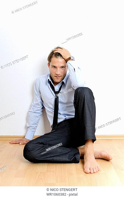 Man sitting casually on the floor