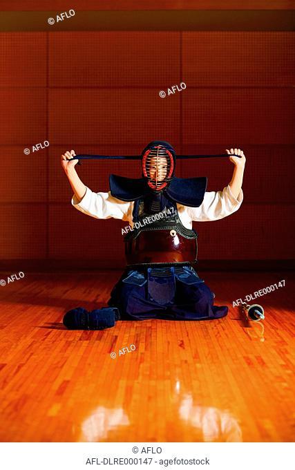 Japanese female kendo athlete preparing for the fight