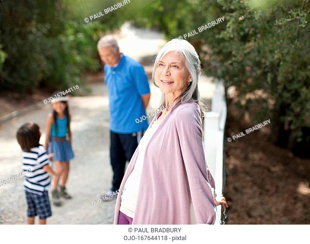 Smiling older woman standing outdoors