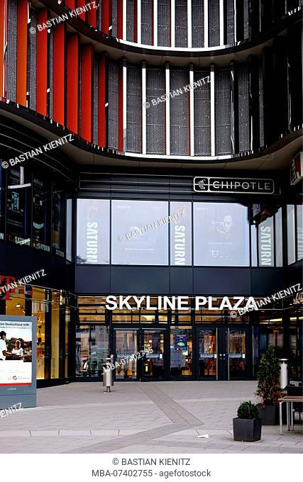 The modern facade and the entrance of the Skyline Plaza shopping center near the Frankfurt fairground