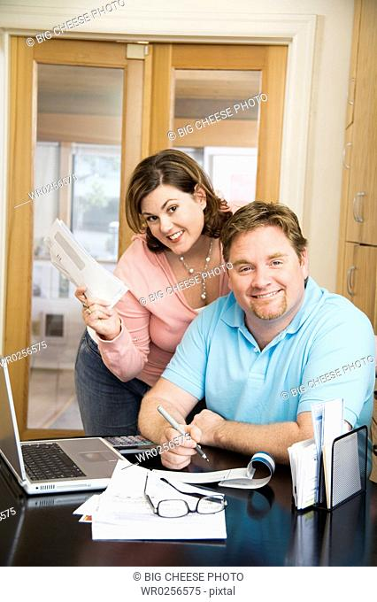 Couple paying bills