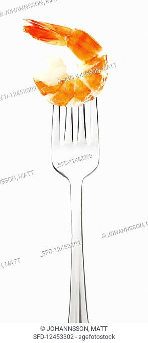 Cooked shrimp on a fork