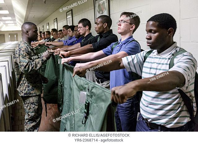 A US Marine watches over newly arrived recruits as they are issued their equipment during receiving at Marine Corps Recruit Depot Parris Island beginning 13...