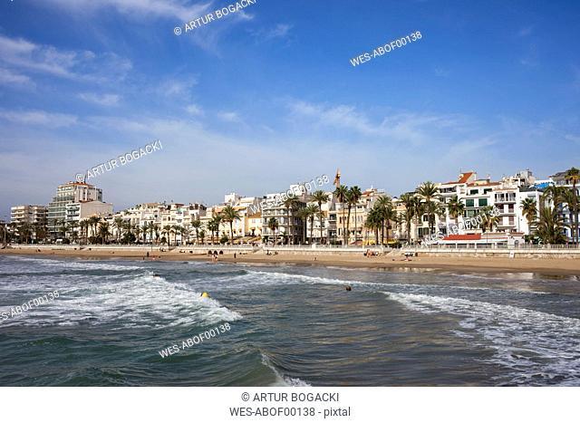 Spain, Catalonia, Sitges, coastal town and beach at Mediterranean Sea