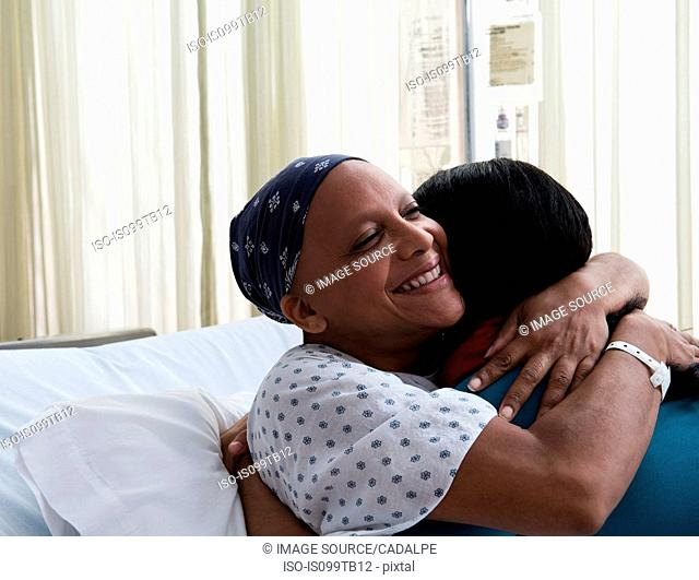 Daughter hugging mother at hospital