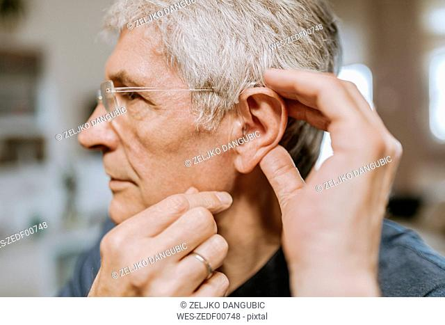 Senior man with hearing aid