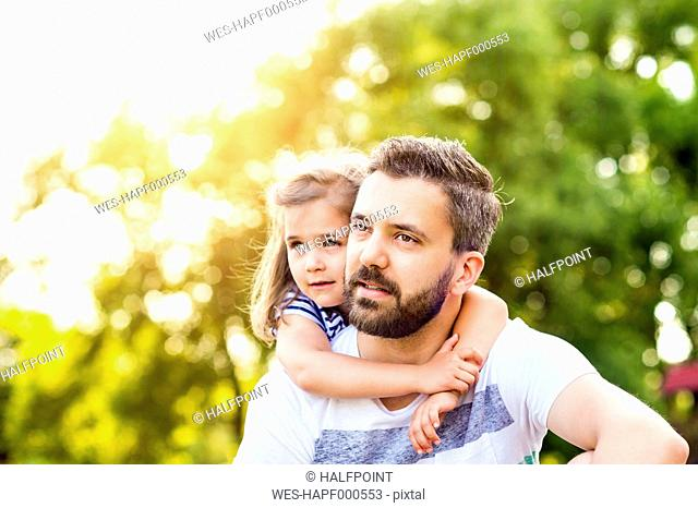 Portrait of father with his little daughter head to head