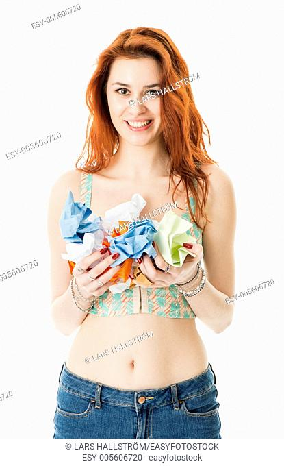 Happy young woman hold crumpled paper waste ready for recycling