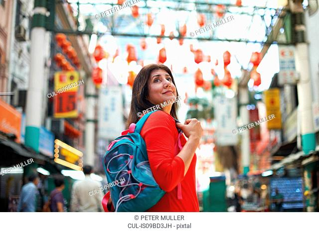 Tourist sightseeing in Chinatown, Kuala Lumpur, Malaysia