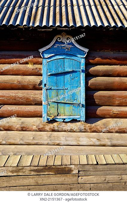 Close-up of a window shade on a traditional log house in the 'Old Believers' Village', settled by members of a 'heretical' offshoot of the Russian Orthodox...