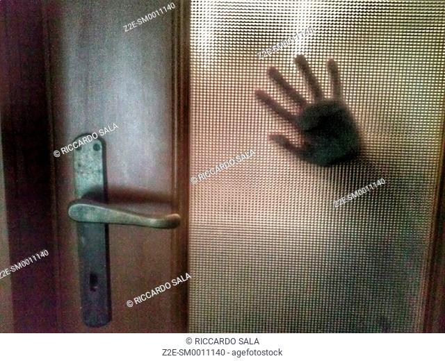 Hand Behind Door Glass