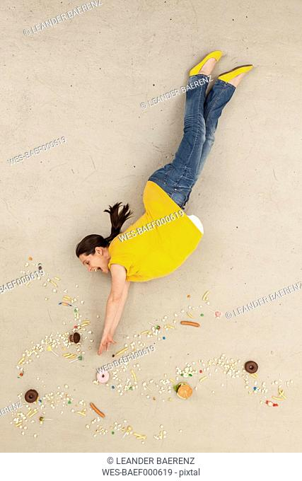 Woman falling in between food