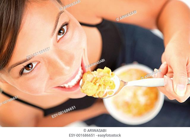 Woman eating cornflakes cereals