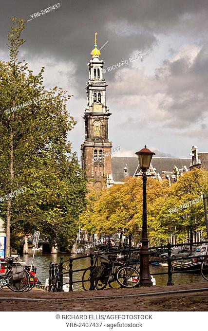 Hemonybrug bridge at Keizersgracht and Leidsegracht with Westerkerk tower in Amsterdam