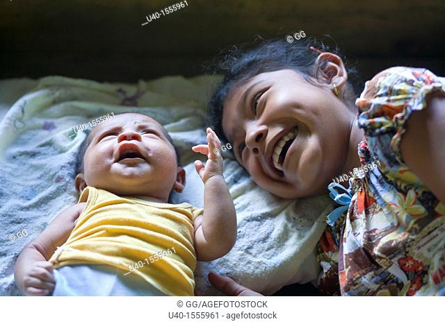 Mayan girl with baby brother