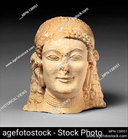 Limestone female head. Period: Archaic; Date: late 6th-early 5th century B.C; Culture: Cypriot; Medium: Limestone; Dimensions: Overall: 11 x 10 1/4 x 8 in