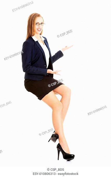 Beautiful caucasian business woman is making a presentation