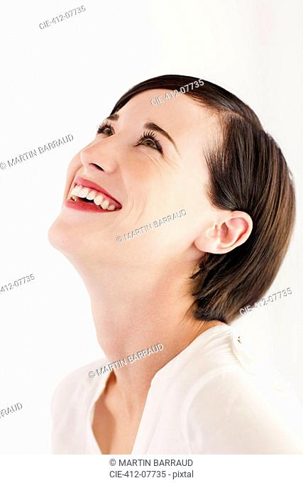 Close up portrait of smiling woman with head back