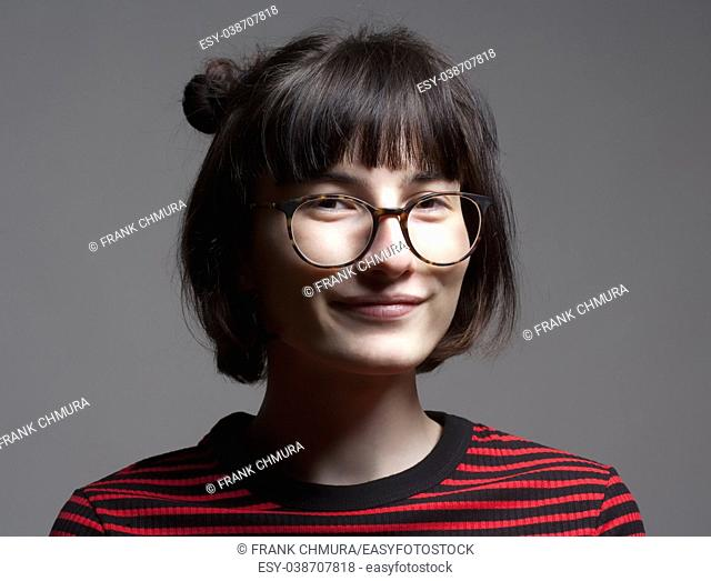 Portrait of a Teenage Girl with Dark Hair and Glasses