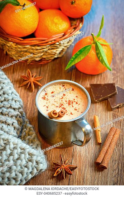 Hot liquid chocolate with winter spices and cloth