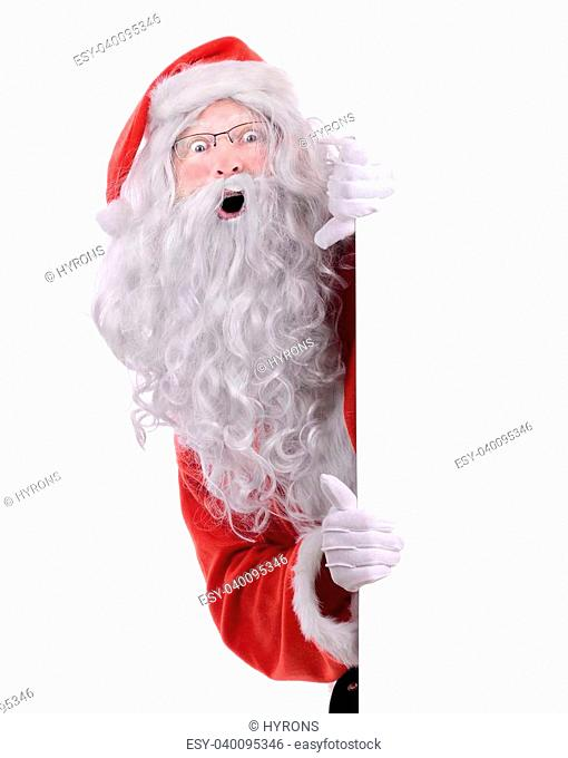 Santa claus peeking from behind a side frame isolated on white
