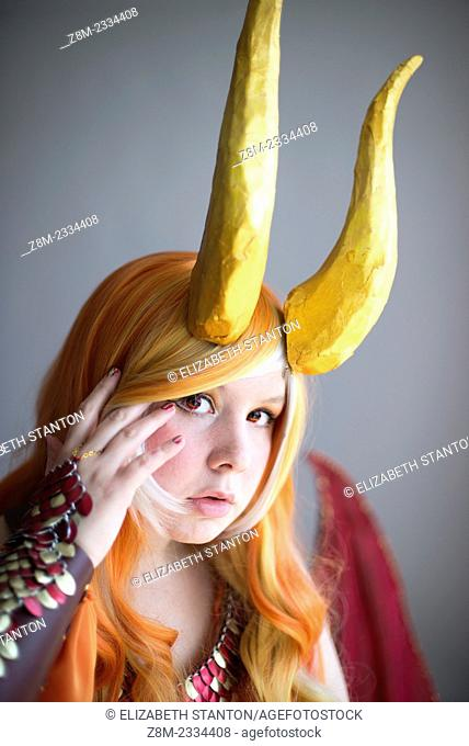 Female cosplay character with horns