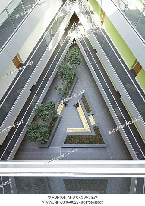 Greenwich Creekside, London, United Kingdom. Architect: Squire + Partners, 2012. High angle view to triangular central atrium